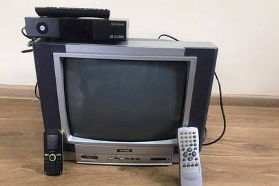 Мобільний телефон «NOMI», ТВ-тюнер марки «Strong» модель ТБВЧ SRT 8500, телевізор марки «Jinlipu»