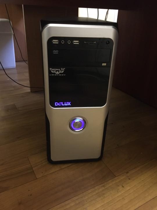 Системний блок Delux чорного кольору зі сріблястими вставками