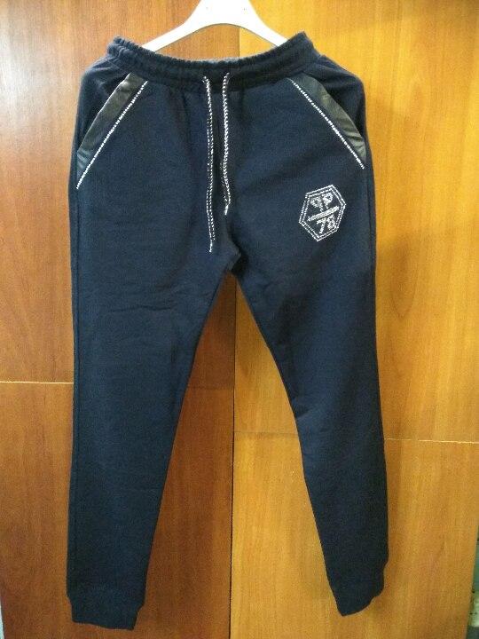 Спортивні штани з текстильних матеріалів, різних розмірів,