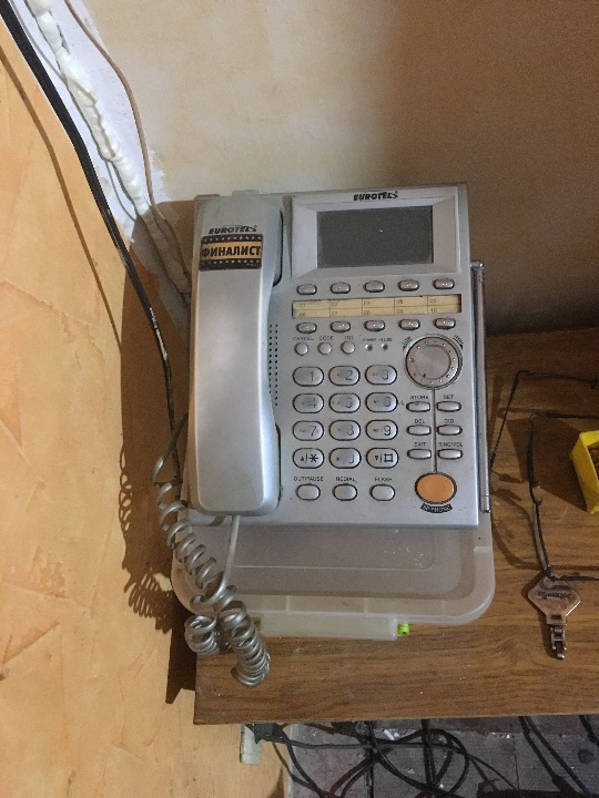 Телефон стаціонарний, сірого кольору