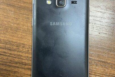"""Телефон марки""""SAMSUNG"""" моделі """"SMJ320H"""" IMEL:352707/09/91/3291/6, IMEL 2:352708/09/91/3291/4 чорного кольору, в якому знаходиться флеш-карта micro SD HC , об'ємом 8Gb"""