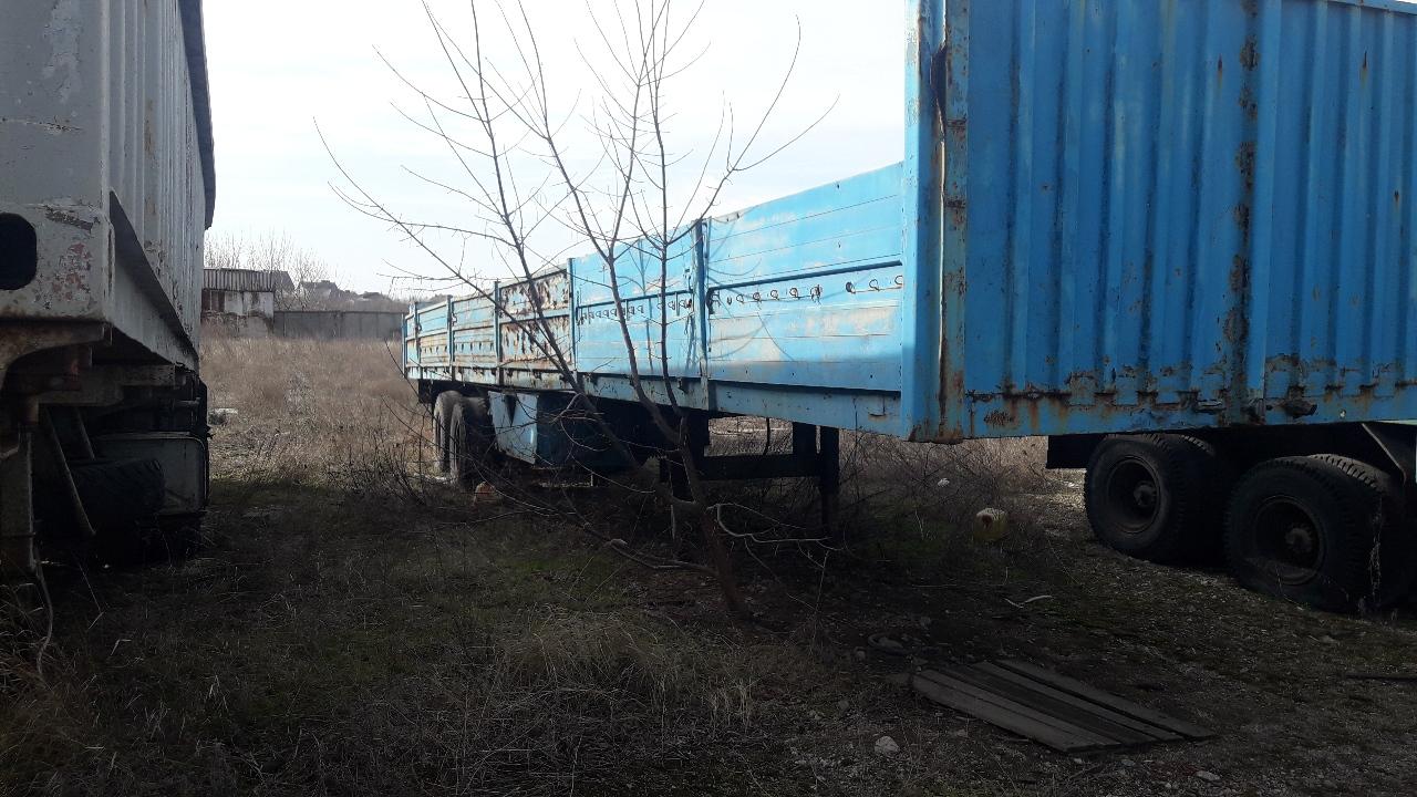 Напівпричіп: МАЗ 9397, бортовий, синього кольору, 1990 р.в., ДНЗ: АН4596ХТ, VIN: ХТМ93970903191